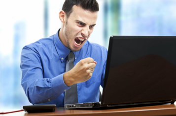 Worker Screaming at Computer